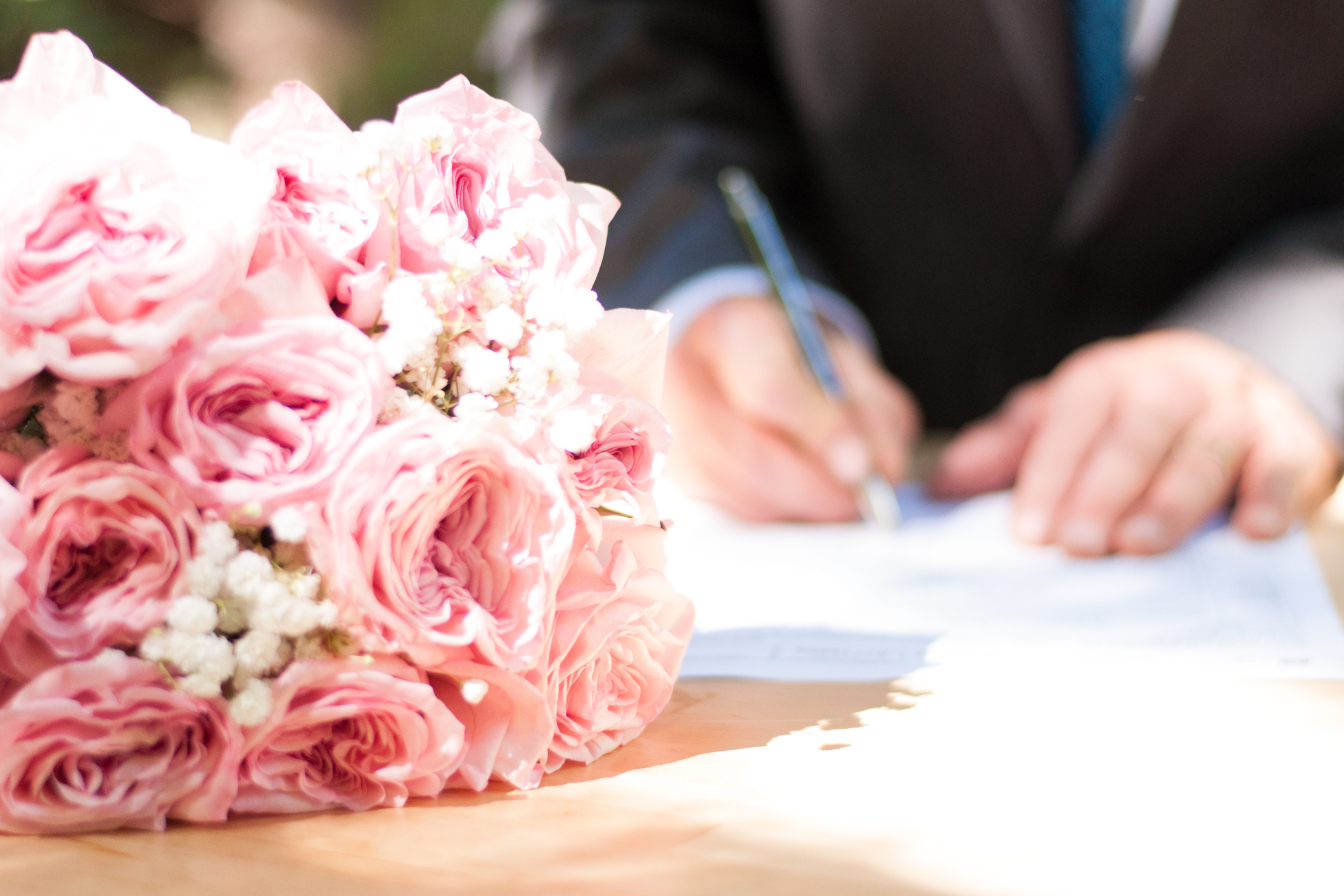 Groom Signing Marriage License